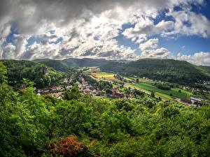 Картинки Германия Дома Небо Бавария Холмы Облака Niederfellendorf Города