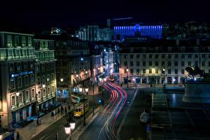 Фотографии Португалия Здания Дороги Улице Ночь Уличные фонари Lisbon Города