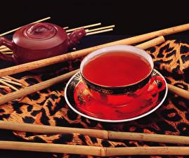 Картинки Напитки Чай Черный фон Чашка Блюдце Пища