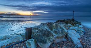 Фото Англия Побережье Камень Рассвет и закат Mudeford Природа