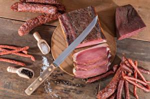 Фото Мясные продукты Колбаса Ветчина Ножик Доски Соль Разделочная доска Пища
