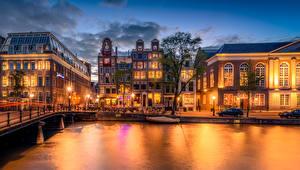 Фото Нидерланды Амстердам Дома Реки Мосты Вечер Уличные фонари Города