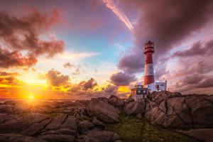 Фото Норвегия Берег Рассветы и закаты Маяки Камень Небо Облака Nymark Rogaland