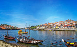 Фотография Португалия Порту Здания Реки Лодки Города