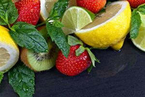 Фотографии Фрукты Лимоны Клубника Киви Серый фон Продукты питания