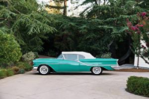 Фото Винтаж Металлик Сбоку 1957 Oldsmobile Starfire 98 Convertible Автомобили