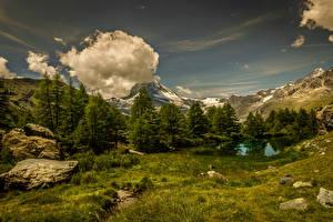 Обои Швейцария Горы Озеро Небо Камень Пейзаж Облака Деревья Траве Kanton Wallis Природа