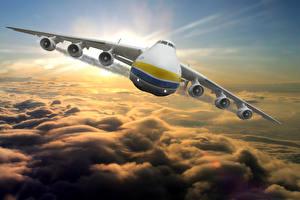 Фото Самолеты Транспортный самолёт Спереди Летящий Облака Российские An-225 Mriya Авиация