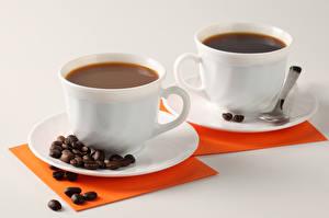 Картинка Кофе Серый фон 2 Чашка Зерна Ложка Блюдце Пища