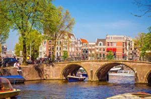 Обои Нидерланды Амстердам Мосты Здания Лодки Водный канал