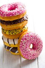 Картинка Выпечка Пончики Сахарная глазурь Доски Пища