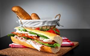 Фотография Сэндвич Ветчина Томаты Продукты питания