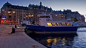 Фото Швеция Стокгольм Здания Вечер Пирсы Речные суда Катера