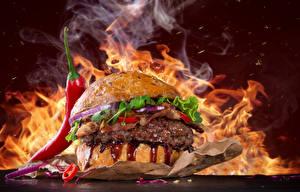 Фото Быстрое питание Гамбургер Пламя Овощи Острый перец чили