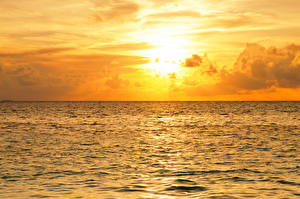 Картинка Мальдивы Море Рассветы и закаты Небо Природа