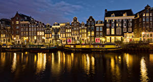 Фотографии Нидерланды Амстердам Здания Пирсы Водный канал Ночные Уличные фонари