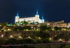 Картинки Испания Толедо Здания Дороги Дворца В ночи Уличные фонари Real Alcazar Seville Города