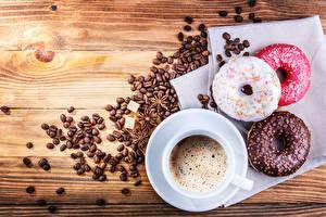 Фотографии Бадьян звезда аниса Пончики Кофе Шоколад Доски Зерна Чашке Еда