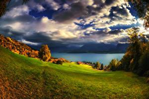 Фотографии Швейцария Пейзаж Озеро Осенние Луга Небо Дерева Облака Oberhofen Природа