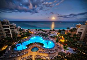 Обои Тропики Курорты Дома Вечер Бассейны Пальмы Отель Carribean Grand Cayman Города