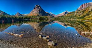 Картинка США Парки Озеро Горы Леса Камни Пейзаж Отражение Medecine Lake Glacier National Park Природа