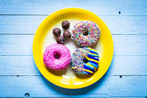 Фото Пончики Шоколад Доски Тарелка Пища