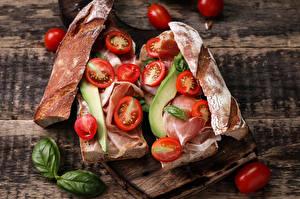 Фотография Фастфуд Сэндвич Хлеб Ветчина Томаты Овощи