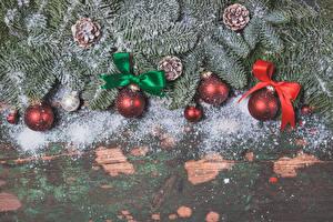 Обои Праздники Рождество Доски Ветвь Шишки Шар Бантик Снег