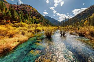 Фото Цзючжайгоу парк Китай Парк Реки Горы Осенние Пейзаж Природа