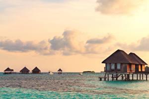Фото Мальдивы Тропический Море Рассветы и закаты Бунгало Природа
