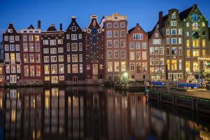 Фотографии Нидерланды Амстердам Здания Пирсы Вечер Водный канал