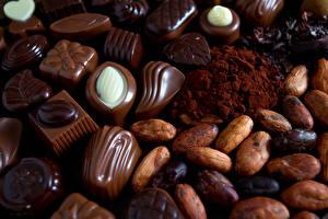 Фотография Сладкая еда Шоколад Конфеты Орехи Какао порошок Пища