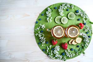 Фото Чай Лимоны Клубника Черника Доски Чашка Ветка Продукты питания