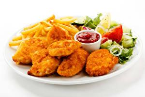 Фотография Вторые блюда Мясные продукты Овощи Картофель фри Быстрое питание Белый фон Тарелка Кетчуп Пища