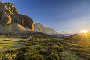 Картинка Чили Рассветы и закаты Гора Альп Траве Скала Andes mountain Природа