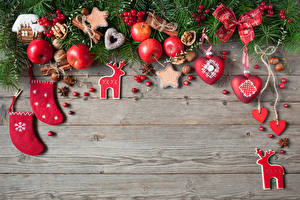 Фото Рождество Яблоки Корица Печенье Орехи Бадьян звезда аниса Доски Бантик Еда
