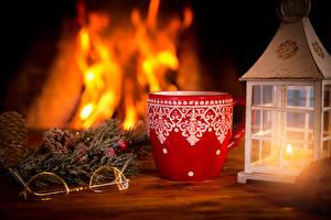Фото Новый год Свечи Пламя Чашка Очки Продукты питания