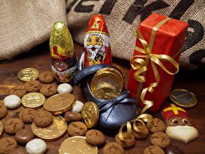 Обои Новый год Печенье Шоколад Сладости Подарки Дед Мороз Еда