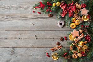 Фотографии Рождество Печенье Лимоны Корица Доски Ветвь Бантик Шишки Пища
