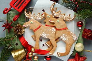 Фото Рождество Олени Печенье Шишки Шар Колокольчики Пища