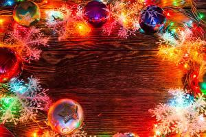 Фотографии Рождество Снежинки Шарики Гирлянда