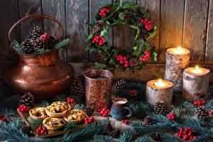 Картинки Рождество Натюрморт Свечи Напитки Стакане Шишки На ветке Дизайн Пища