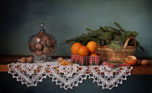 Обои Новый год Натюрморт Орехи Мандарины Ветки Корзинка Еда