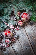Обои Рождество Доски Ветвь Шар Шишки Снег