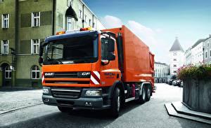 Фотография Грузовики Даф тракс Оранжевый EEV CF75.310 FAN 6х2 Машины