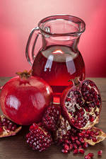 Картинки Напитки Гранат Кувшин Зерна Пища