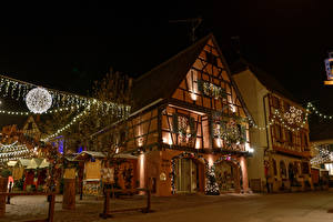 Картинка Франция Здания Рождество Вечер Улица Электрическая гирлянда Eguisheim Alsace