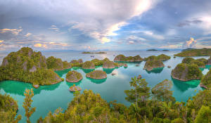 Картинки Индонезия Тропики Море Небо Утес Besir West Papua Природа