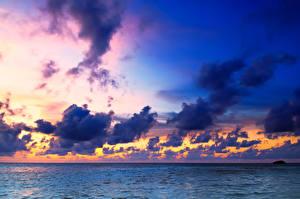 Фотографии Мальдивы Тропический Море Рассветы и закаты Небо Облачно