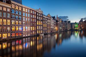 Обои Нидерланды Амстердам Здания Вечер Водный канал Города